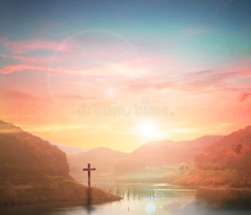Silhouette cross on Calvary mountain sunset background. Easter concept royalty free stock photography