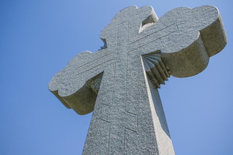 Christian cross on blue sky background stock photo