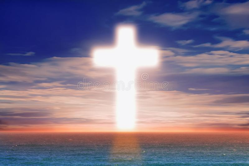 Christian Cross in the middle of the sea stock photography