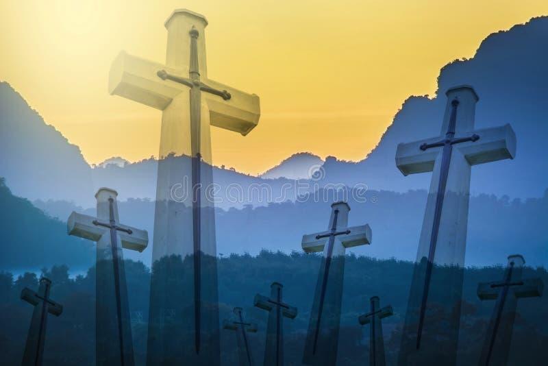 Christian cross with overlapped mountain range stock photos