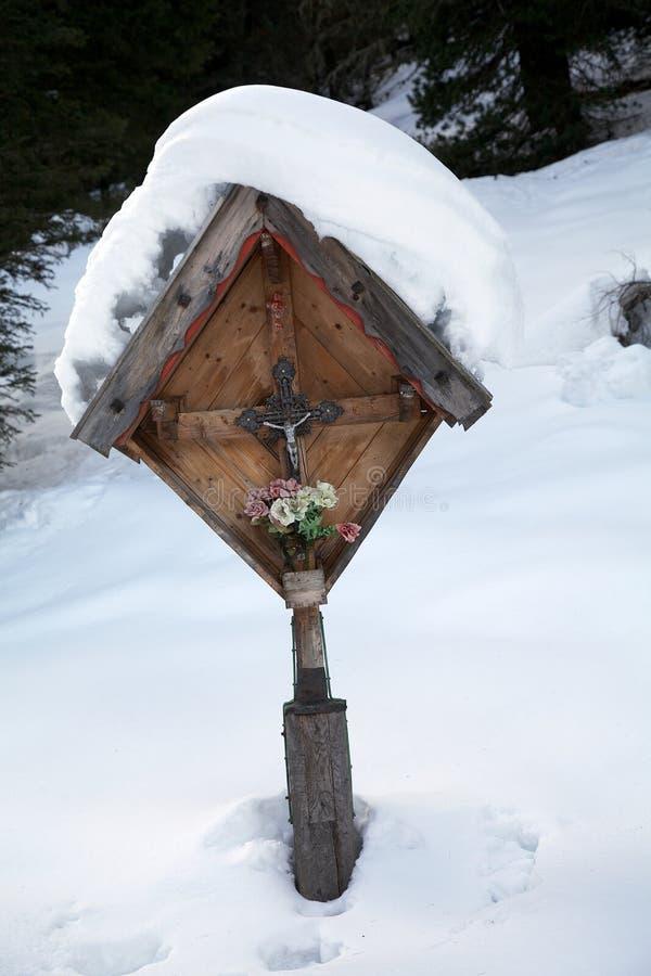 Christian cross among the snow