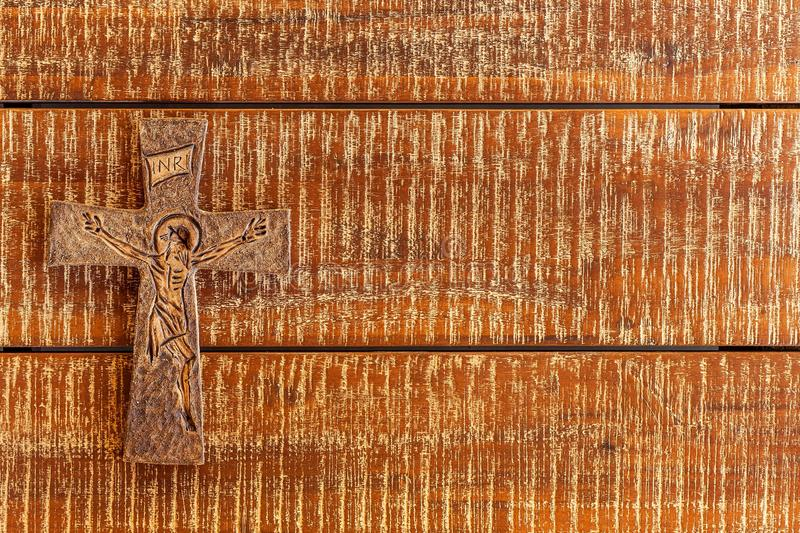 Christian cross on the wooden table. Beautiful old cross with jesus on the old wooden floor. Symbol of Faith stock photography