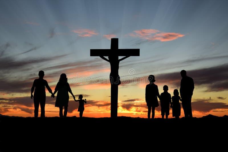 Christian Families Standing Before Cross di Gesù immagine stock