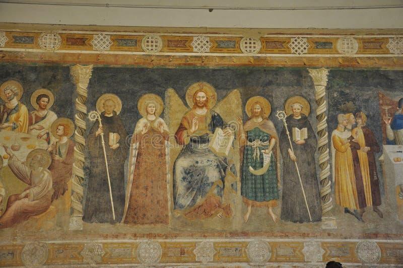 Christian frescoes, Pomposa abbey, Italy. Jesus Christ and Saints. Frescoes in the Pomposa abbey: a Benedictine monastery in the comune of Codigoro near Ferrara stock photography