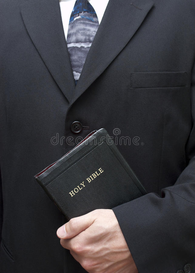 Christian Holding Holy Bible Good Book Religion. A respectful and clean abstract image portraying a Christian man holding the Holy Bible, also known as the Good stock photo