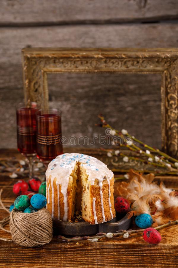 Christian holidays photos of Easter food in a rustic style. The table is covered with Easter cakes and painted eggs. Family Orthodox holiday royalty free stock image