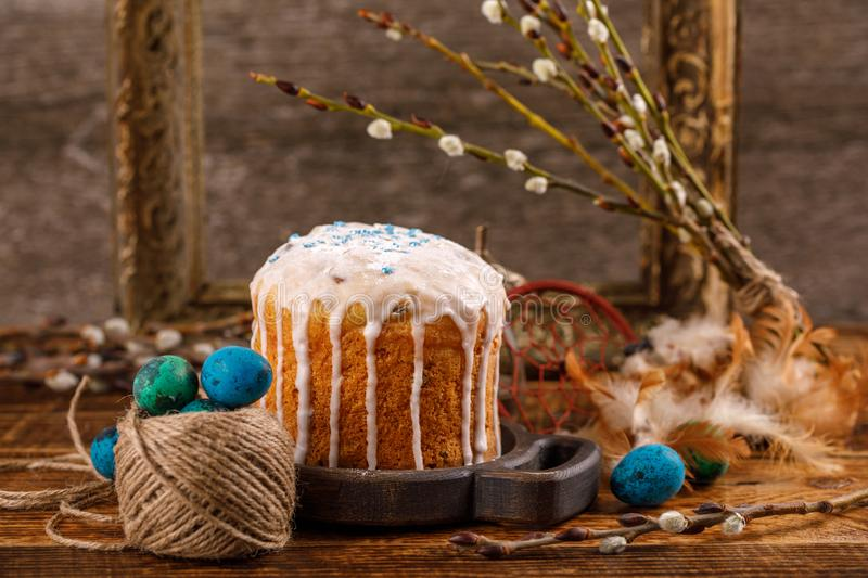 Christian holidays photos of Easter food in a rustic style. The table is covered with Easter cakes and painted eggs. Family Orthodox holiday stock images