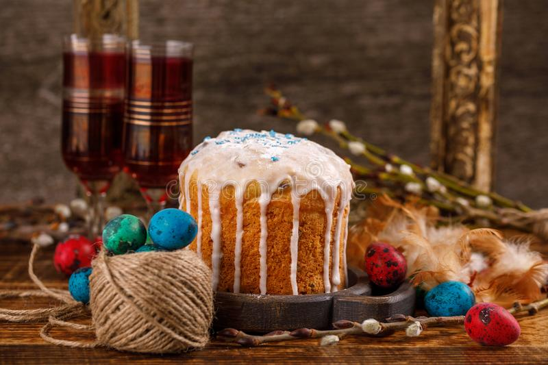 Christian holidays photos of Easter food in a rustic style. The table is covered with Easter cakes and painted eggs. Family Orthodox holiday stock photography
