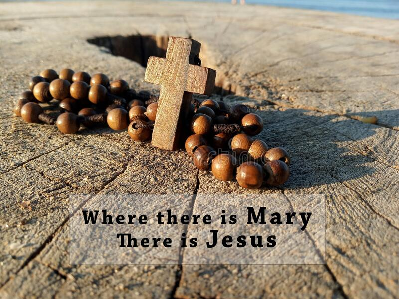 christian inspirational quote where there mary jesus wooden rosary christ holy cross crucifix rustic table catholic symbol 173084865