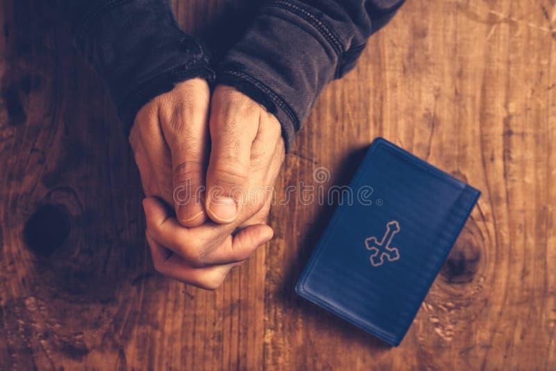 Christian man praying royalty free stock photo