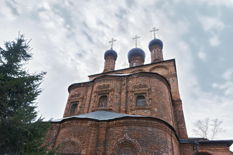 Christian monastery and tree. Christian monastery of the seventeenth century and tree stock photography