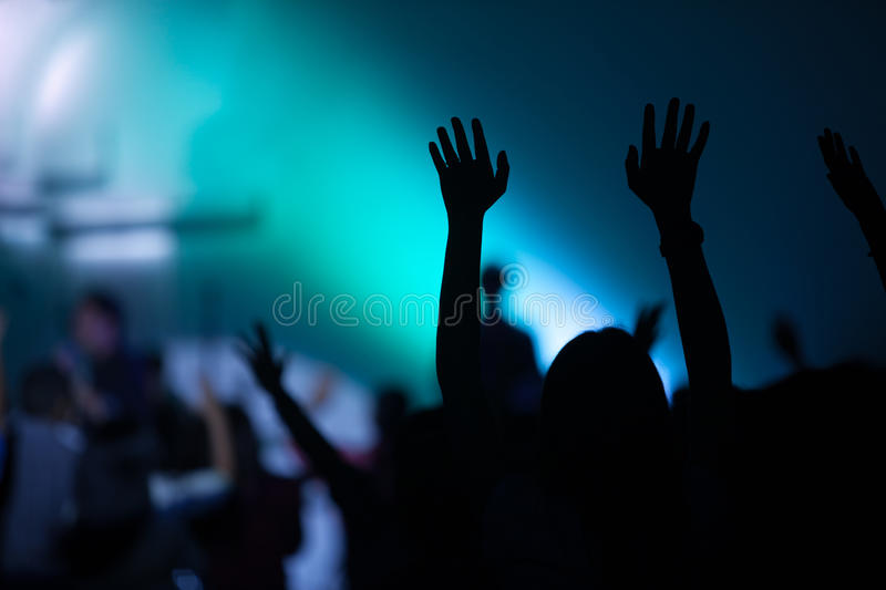 Christian music concert with raised hand stock images