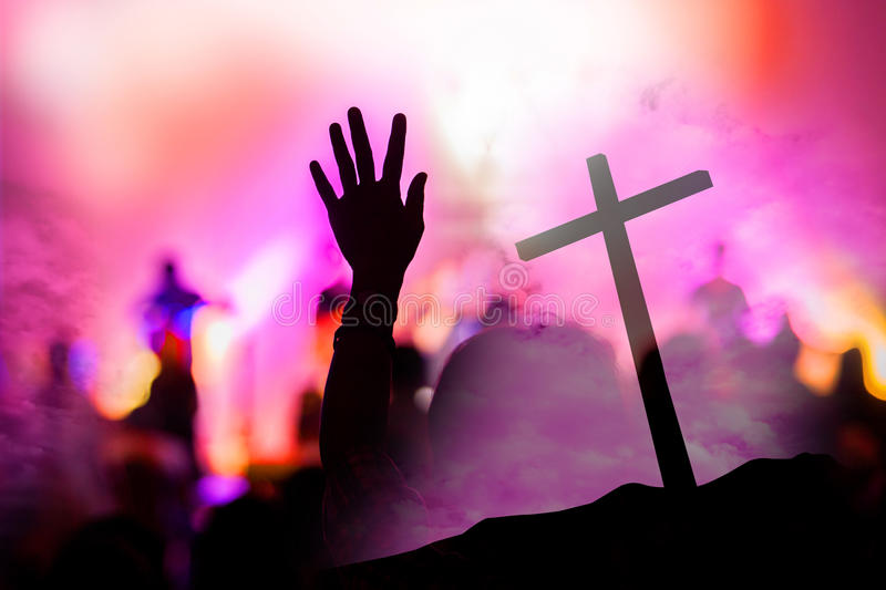Christian music concert with raised hand stock photography