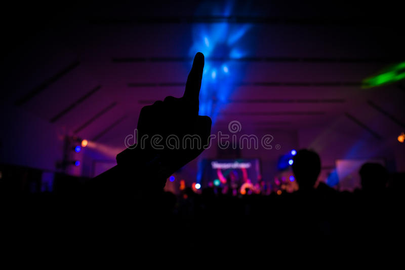 Christian music concert with raised hand royalty free stock image