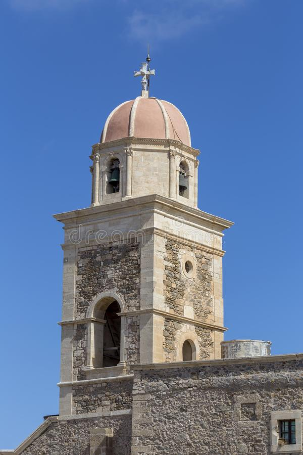 Christian, Orthodox monastery close-up Lassithi area, island Crete, Greece. Stony, Christian, Orthodox monastery bell tower in the mountains in the autumn, sunny royalty free stock image