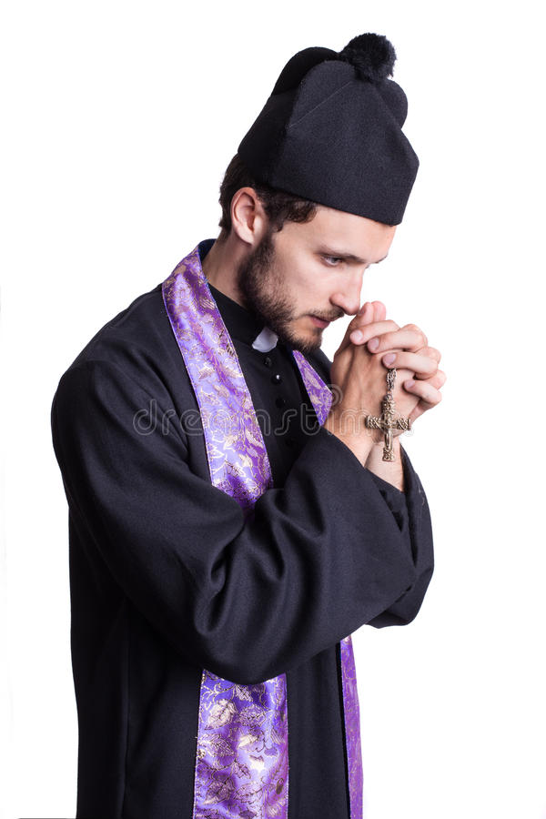 Christian priest praying royalty free stock photo