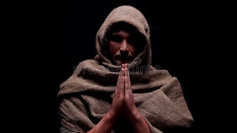 Christian prophet in robe praying, asking for soul salvation, belief in god. Stock photo royalty free stock photos