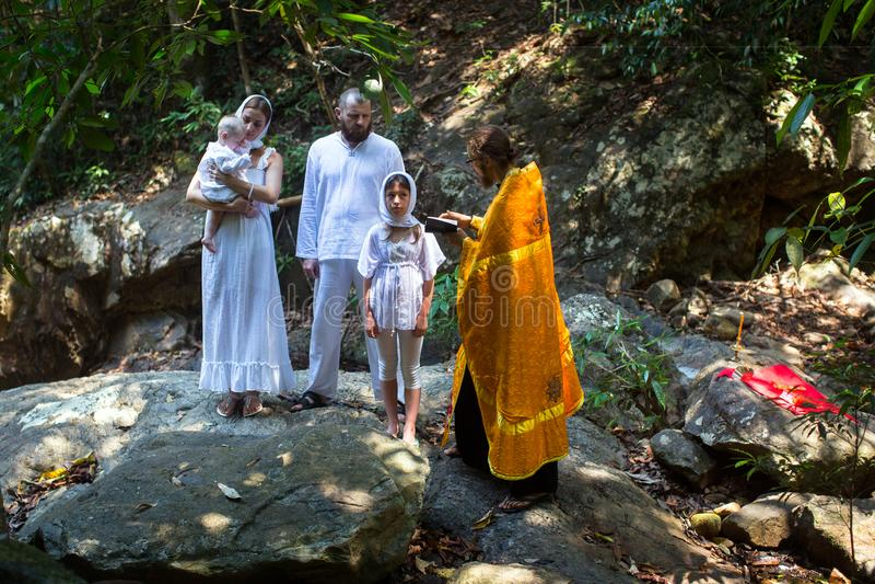 During Christian sacrament of spiritual birth - Baptism. KOH CHANG, THAILAND - MAR 10, 2018: During Christian sacrament of spiritual birth - Baptism. There are royalty free stock images