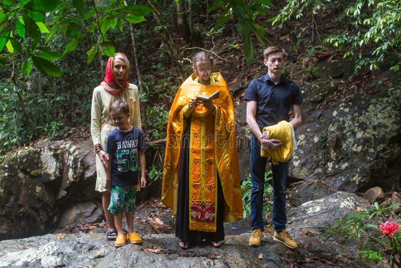 During Christian sacrament of spiritual birth - Baptism. KOH CHANG, THAILAND - MAR 9, 2018: During Christian sacrament of spiritual birth - Baptism. There are royalty free stock images