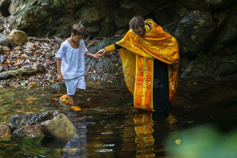 During Christian sacrament of spiritual birth - Baptism. KOH CHANG, THAILAND - MAR 9, 2018: During Christian sacrament of spiritual birth - Baptism. There are royalty free stock photos