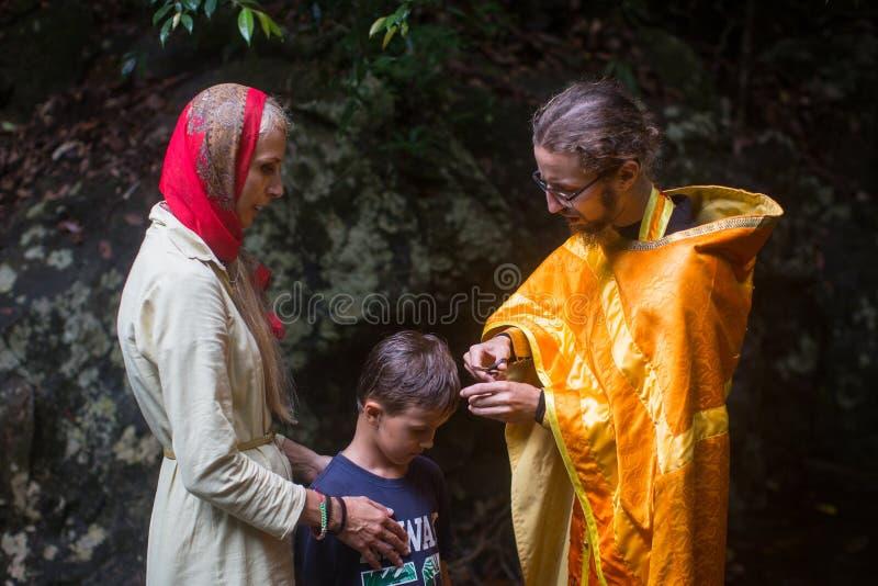 During Christian sacrament of spiritual birth - Baptism. KOH CHANG, THAILAND - MAR 9, 2018: During Christian sacrament of spiritual birth - Baptism. There are stock photography