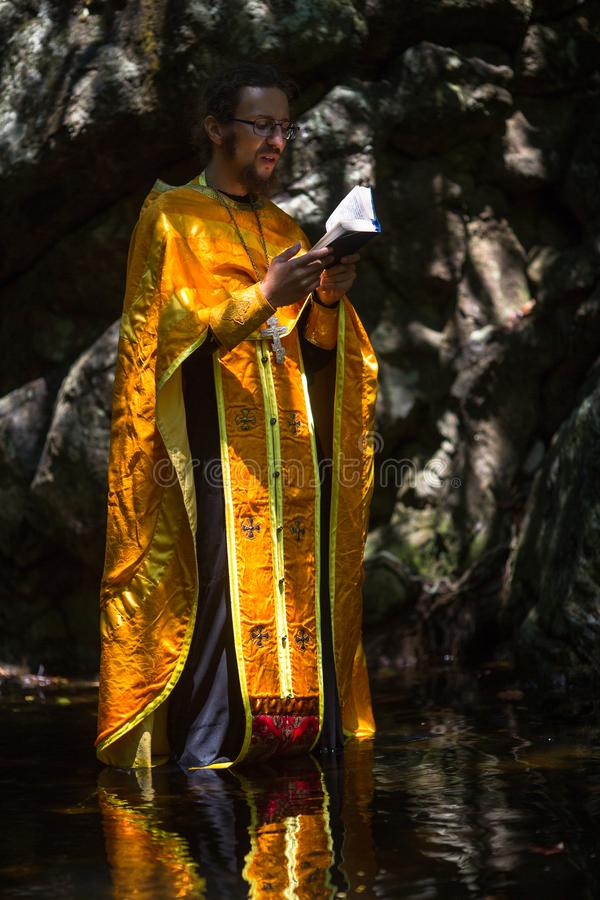 During Christian sacrament of spiritual birth - Baptism. KOH CHANG, THAILAND - MAR 10, 2018: During Christian sacrament of spiritual birth - Baptism. There are stock image