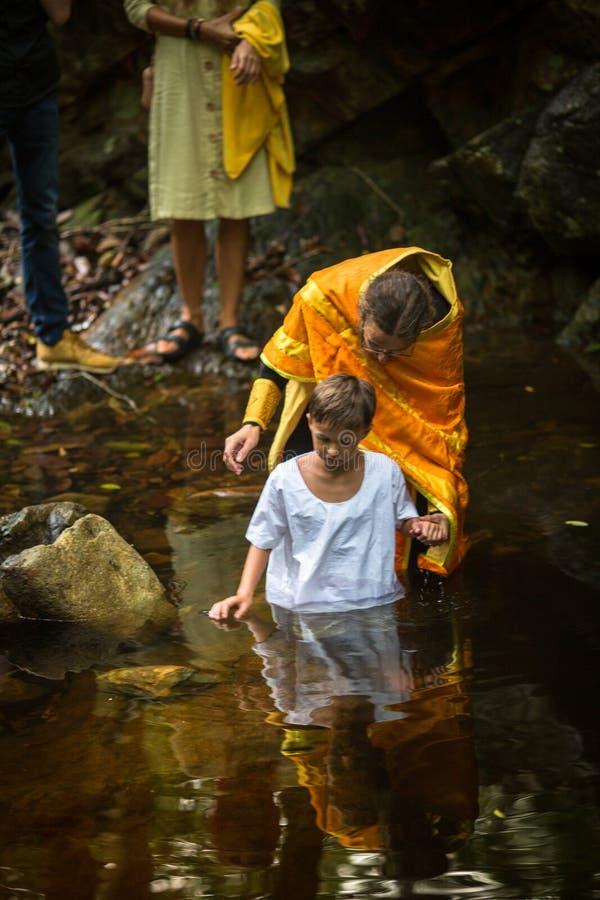 During Christian sacrament of spiritual birth - Baptism. KOH CHANG, THAILAND - MAR 9, 2018: During Christian sacrament of spiritual birth - Baptism. There are stock photo