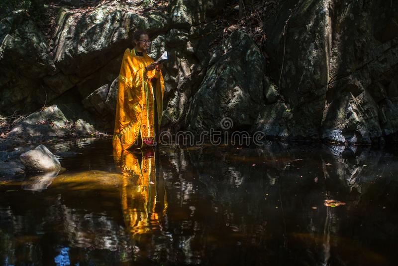 During Christian sacrament of spiritual birth - Baptism. KOH CHANG, THAILAND - MAR 10, 2018: During Christian sacrament of spiritual birth - Baptism. There are stock photo