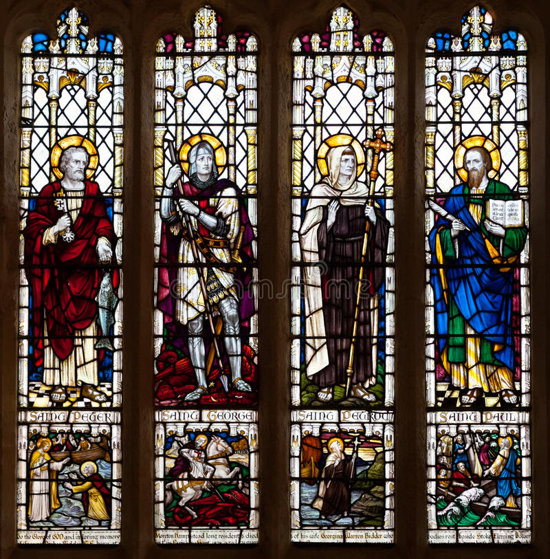 Christian Saints Stained Glass Window. The Christian saints Peter, George, Petroc and Paul depicted in a stained glass window royalty free stock image