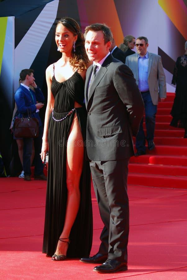 Christian Slater and Sofia Arzhakovskaya smile and pose for photos. Actor Christian Slater and actress Sofia Arzhakovskaya (also known as Sofia Skya) at XXXV royalty free stock photography