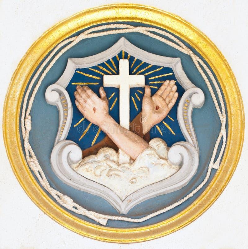 Christian symbols of cross and stigmata stock photos