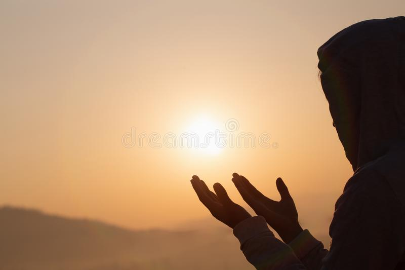 Christian woman  hands praying to god  Woman Pray for god blessing to wishing have a better life. begging for forgiveness and. Believe in goodness royalty free stock photo