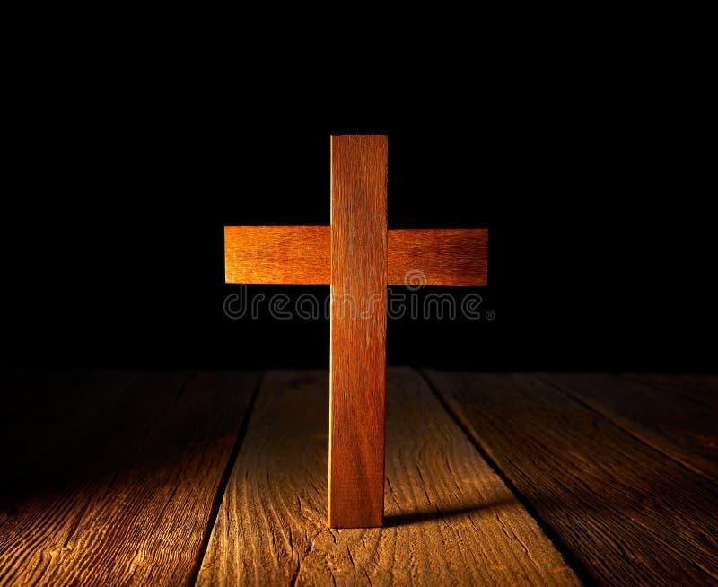 Christian wood cross on black background stock photo