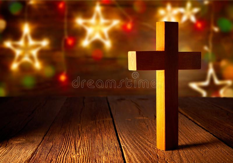 Christian wood cross on Christmas stars. Wooden background royalty free stock photography