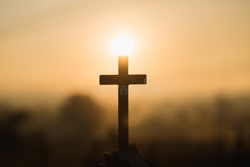 Christian wooden cross on a background with dramatic lighting, Jesus Christ cross, Easter, resurrection concept. Christianity,. Religion copyspace background stock image