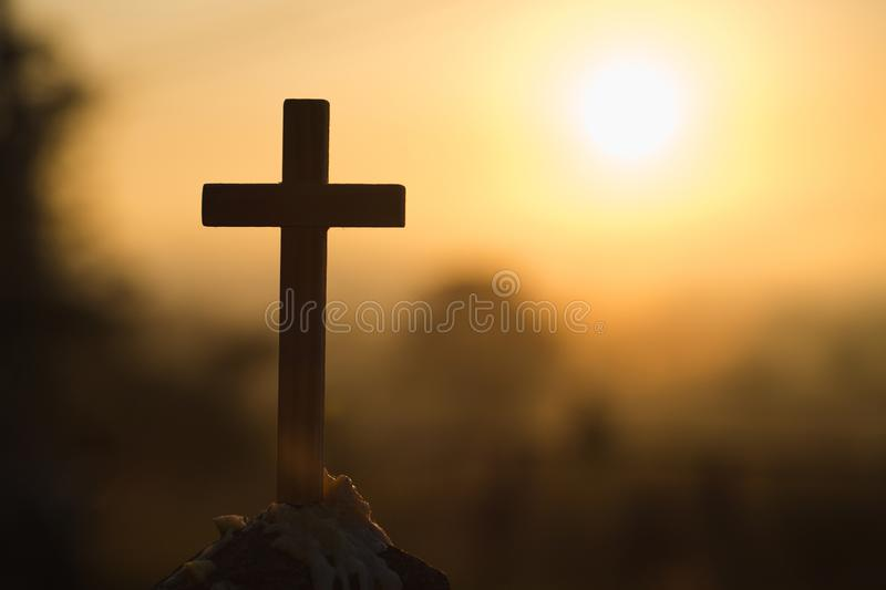 Christian wooden cross on a background with dramatic lighting, Jesus Christ cross, Easter, resurrection concept. Christianity,. Religion copyspace background stock photos