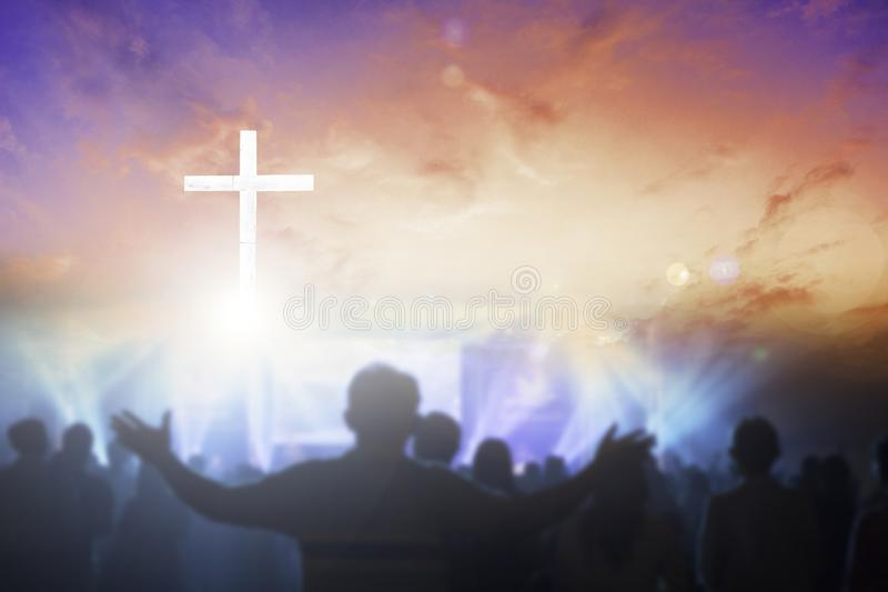 Christians raising their hands in praise and worship at a night music concert. Christian concept background:Eucharist Therapy Bless God Helping Repent Catholic royalty free stock image