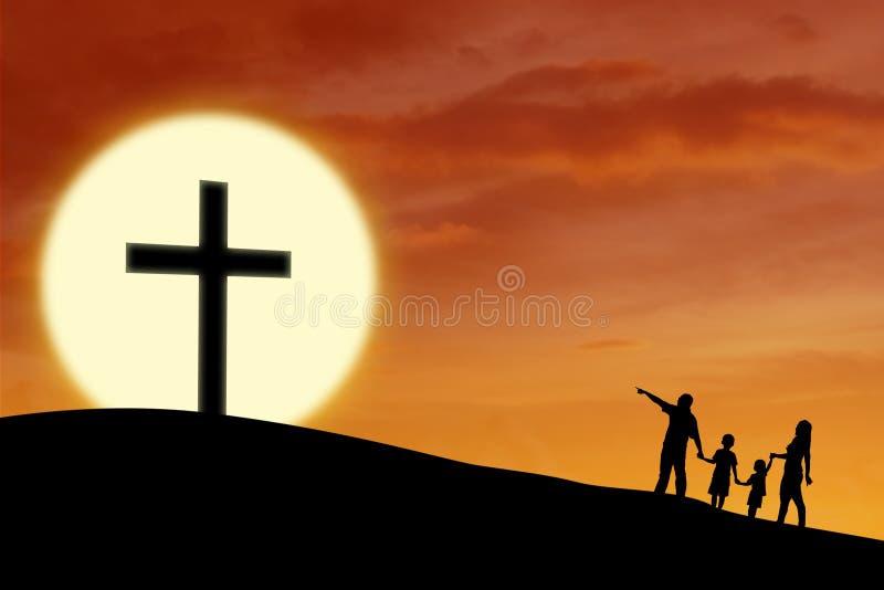 Christliche Familie am Kreuz stockfotografie