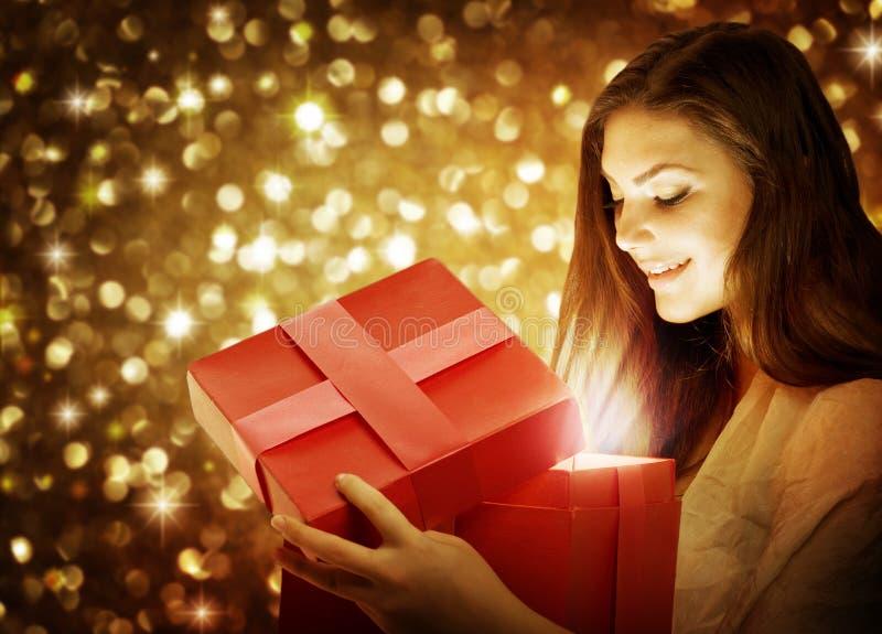 Christmas. Beautiful Young Woman With Christmas Gift