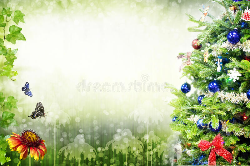 Christmas. A christmas tree with flowers and two butterflies. Concept image for Christmas in a garden or natural environment