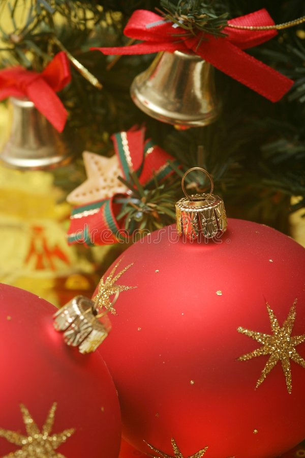 Christmas. Still life. red ball and tree on golden background stock photo