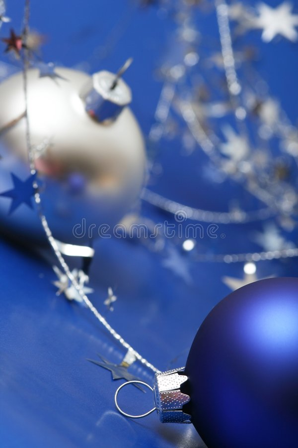 Christmas. Blue ball on blue background with silver stars royalty free stock photo