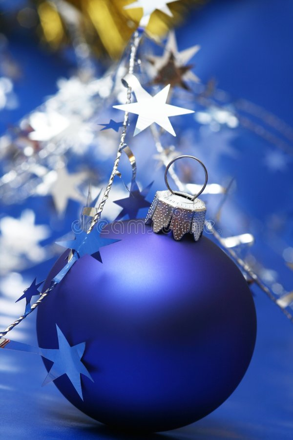 Christmas. Blue ball on blue background with silver stars royalty free stock images