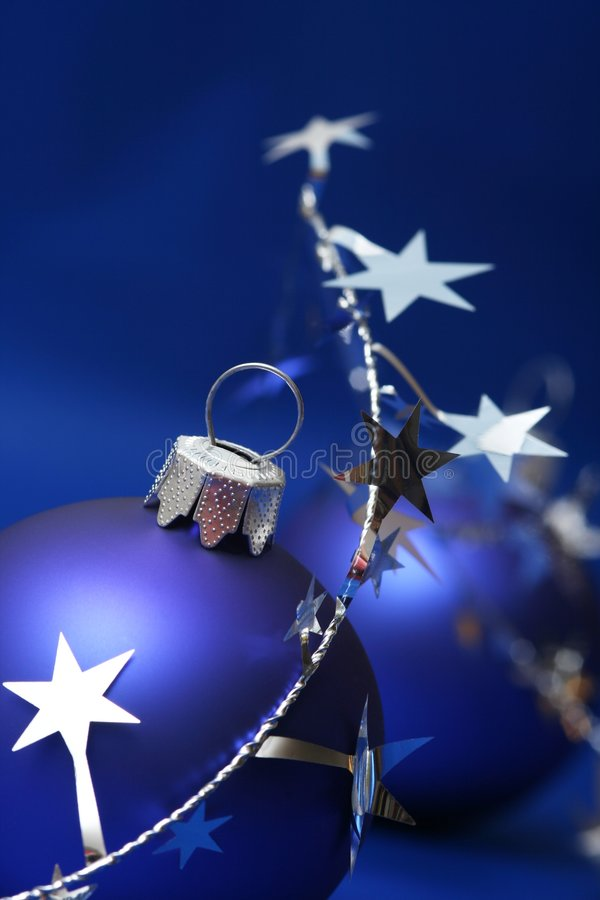 Christmas. Blue ball on blue background with silver stars royalty free stock photos