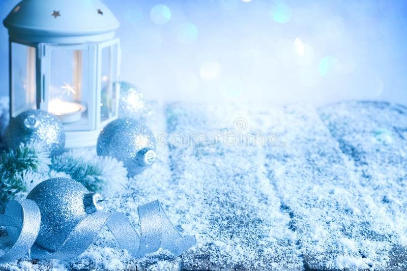 Christmas abstract decoration ornament background with baubles lantern and ribbon on empty table in blue. Night royalty free stock images