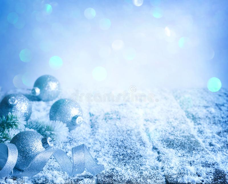 Christmas abstract decoration ornament background with baubles and ribbon on empty table in blue. Night stock images