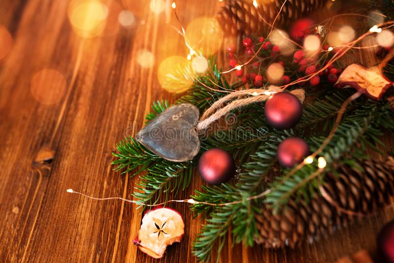 Christmas accessories homemade. On rustic wooden table with golden bokeh stock photos