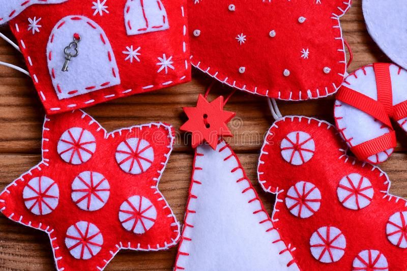 Download Felt Christmas Decor On A Wooden Background Tree Star House