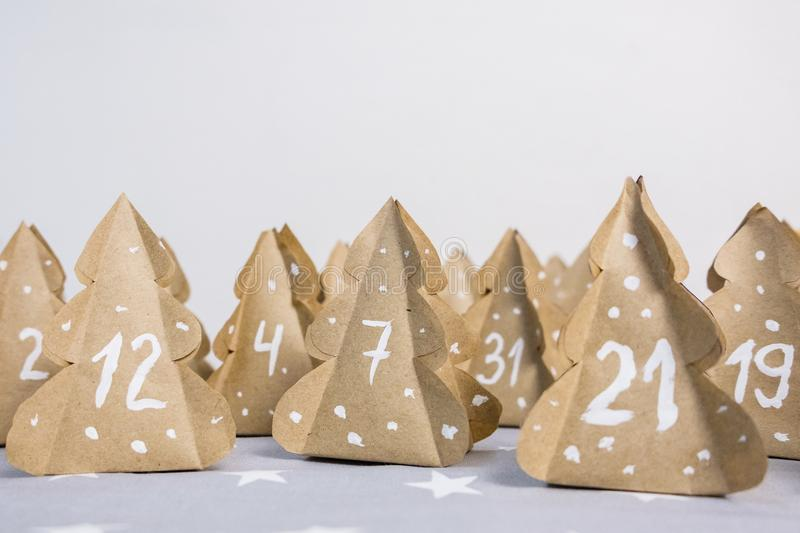 Handmade Christmas advent calendar Christmas trees Kraft paper with numbers. stock image