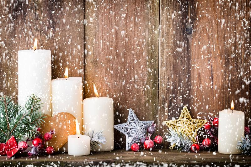Christmas Advent candles with festive decor.  royalty free stock images